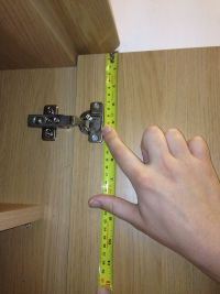Measuring kitchen door hinge position