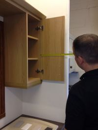 Measuring hinge position on back of kitchen cupboard door