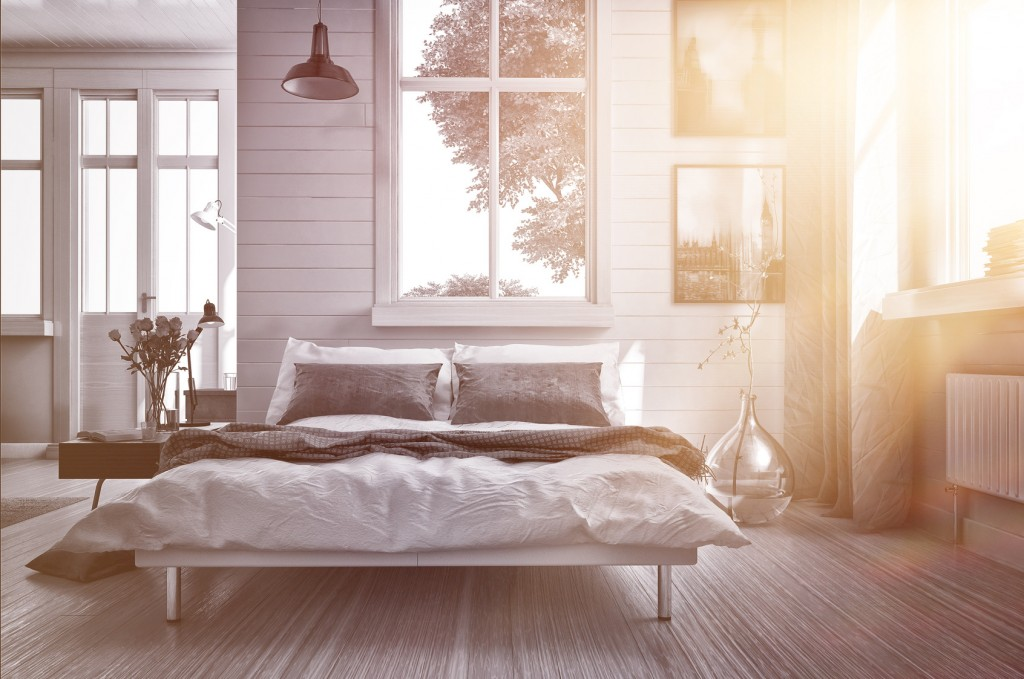 Luxury bedroom lit by warm glowing sun flare